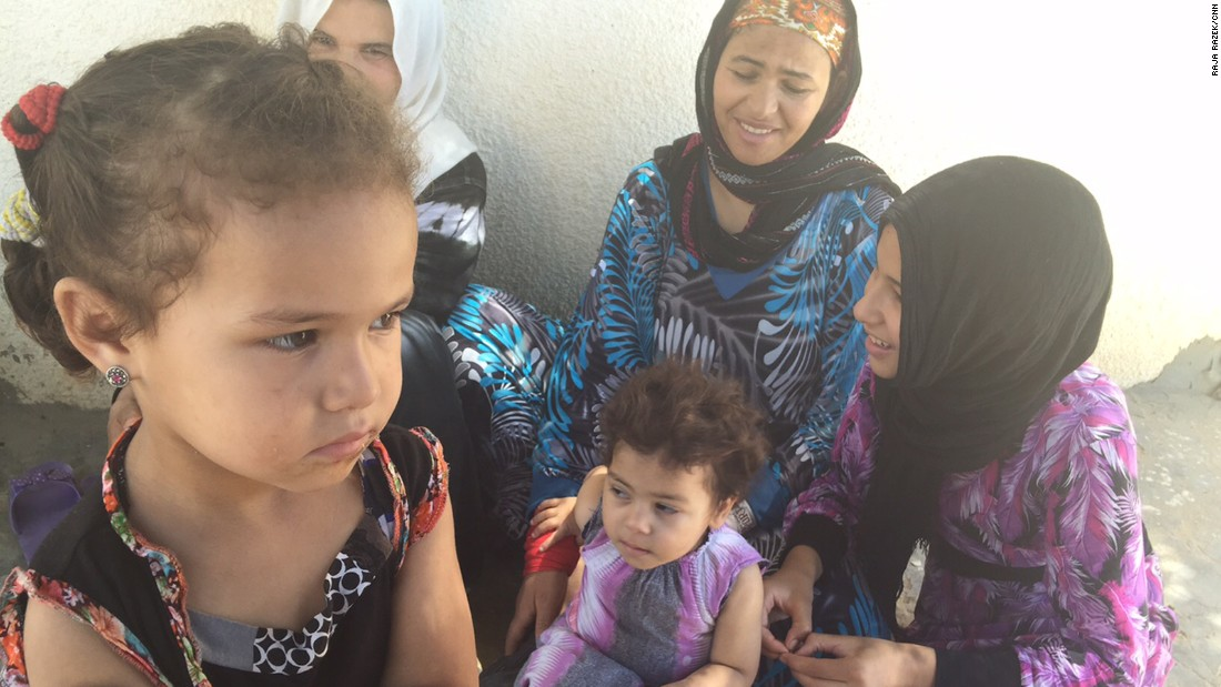 Women and children gather in Al Zuhour district in Kasserine.