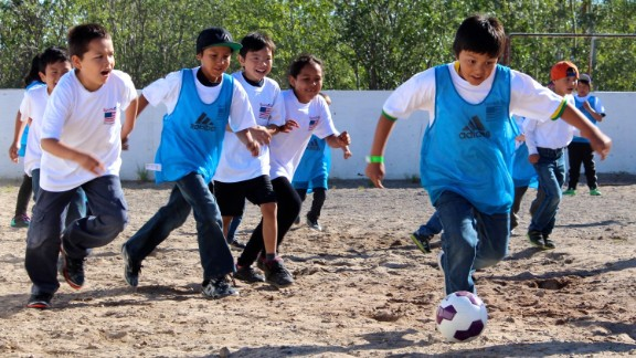 Students at Chief Jimmy Bruneau School, Behchoko play on the best outdoor surface the school has. The ground is under ice for more than half of the year, so grass fields are difficult to maintain.