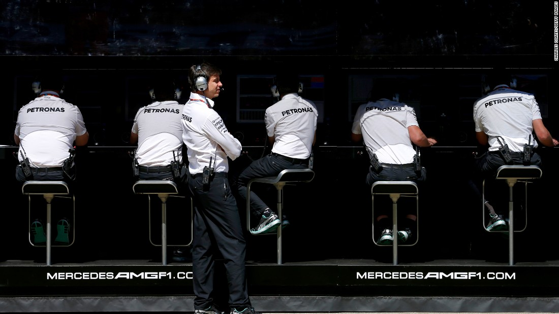 Her husband is Mercedes GP Executive Director Toto Wolff, who is pictured looking on from the pit wall.