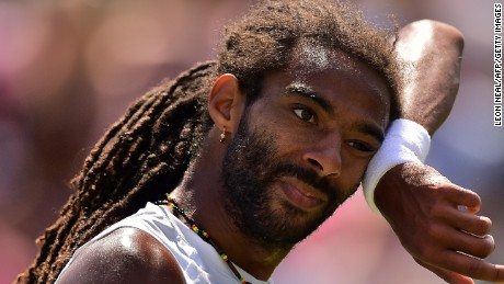 Feeling the heat: Germany's Dustin Brown on his way to a third round defeat to Viktor Troicki of Serbia at Wimbledon.
