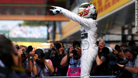 Lewis Hamilton celebrates in parc ferme after claiming pole at the British Grand Prix at Silverstone.