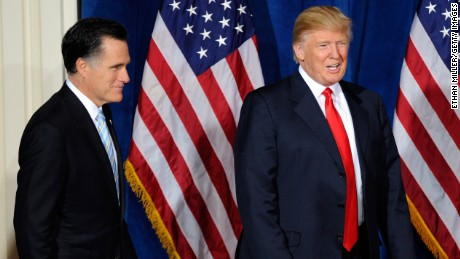 Republican presidential candidate, former Massachusetts Gov. Mitt Romney (L) and Donald Trump arrive at a news conference held by Trump to endorse Romney for president at the Trump International Hotel & Tower Las Vegas February 2, 2012 in Las Vegas, Nevada.