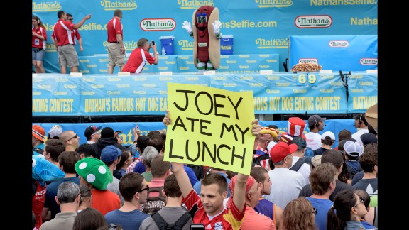"""""""Joey ate my lunch,"""" reads a sign carried by one of the many spectators. Actually, this year it was Matt Stonie."""