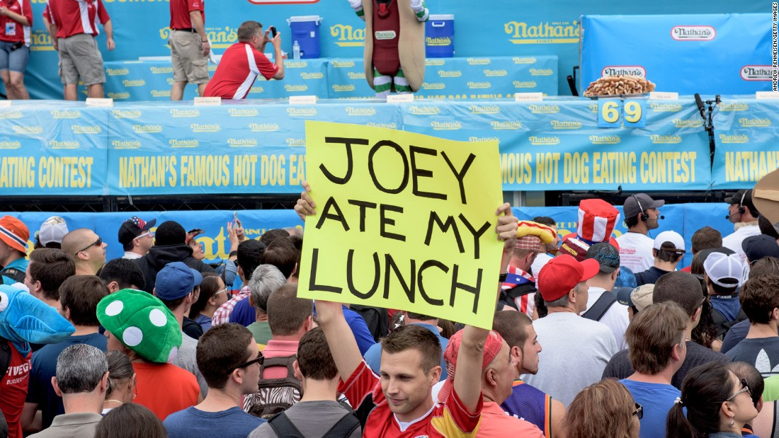 """Joey ate my lunch,"" reads a sign carried by one of the many spectators. Actually, this year it was Matt Stonie."