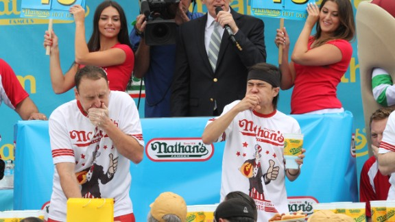Joey Chestnut, left, and rival Matt Stonie struggle to down hot dogs and buns on the Fourth of July at Coney Island.