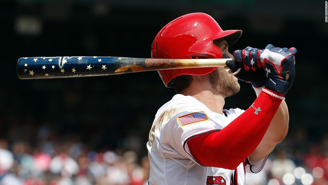 Washington Nationals' Bryce Harper watches his two-run homer as he holds his Independence Day-themed bat during a game against the San Francisco Giants at Nationals Park on Saturday.