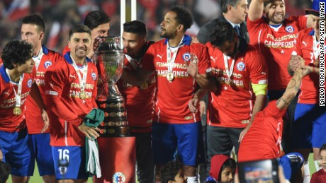 Chile's players celebrate with the Copa America trophy after being Argentina on penalties in the final in Santiago.