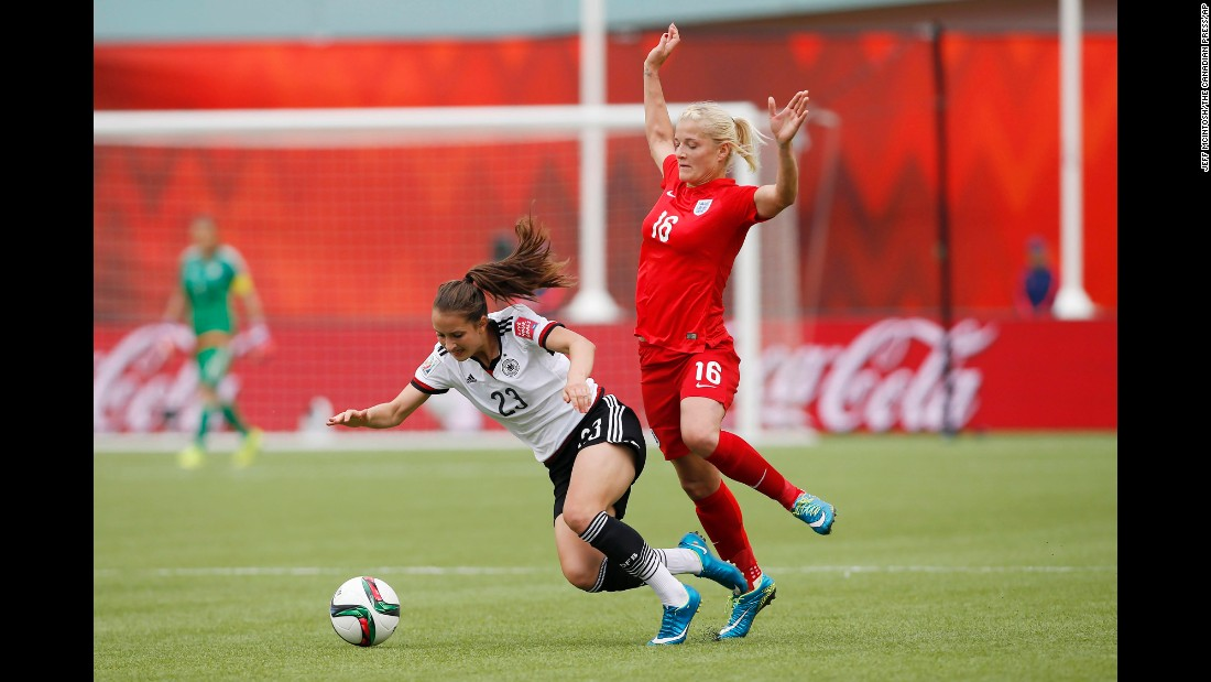 England's Katie Chapman knocks down Germany's Sara Dabritz during the second half of the Women's World Cup soccer third-place match on Saturday.