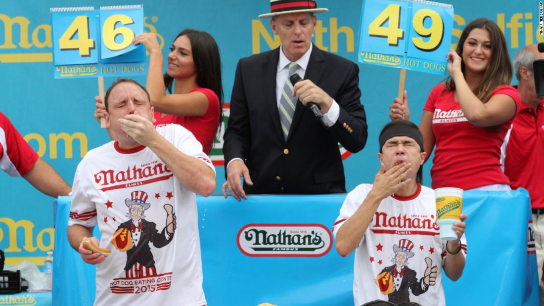 Joey Chestnut, left, and Matt Stonie compete in Nathan's Famous Fourth of July International Hot Dog Eating Contest men's competition Saturday. Stonie took the win with a total of 62 hot dogs in 10 minutes.