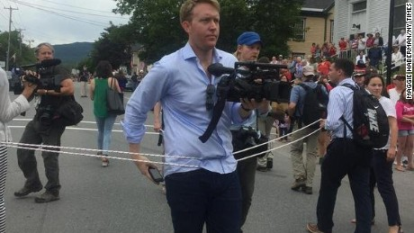 Hillary Clinton's campaign used a rope to keep journalists away from the candidate on Saturday while she walked in the Gorham, New Hampshire, July Fourth parade.
