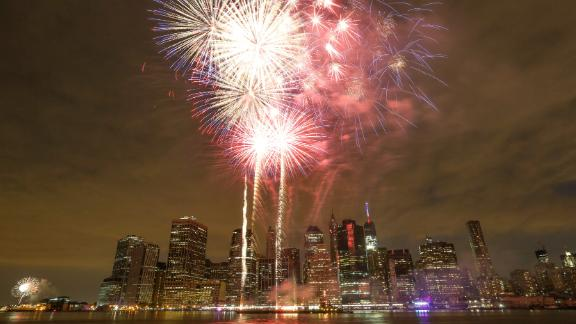 Fireworks illuminate the sky over the East River during the 39th annual Macy's Fourth of July fireworks show in New York City on Saturday, July 4.