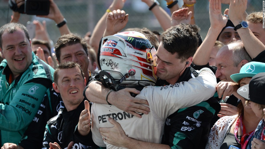 Hamilton shared his moment of victory with his Mercedes pit crew who played such a key role.