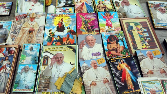 Images of the Pope are sold outside of Samanes Park on July 5.