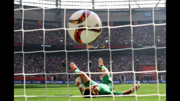 Ayumi Kaihori of Japan reacts as a ball from Carli Lloyd rolls into the goal box.