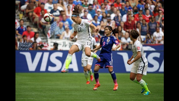 Lauren Holiday of the United States heads the ball above Japan's Nahomi Kawasumi.