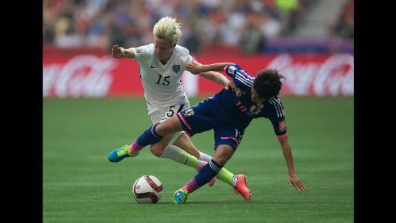 Megan Rapinoe of the United States and Homare Sawa of Japan fight for the ball.