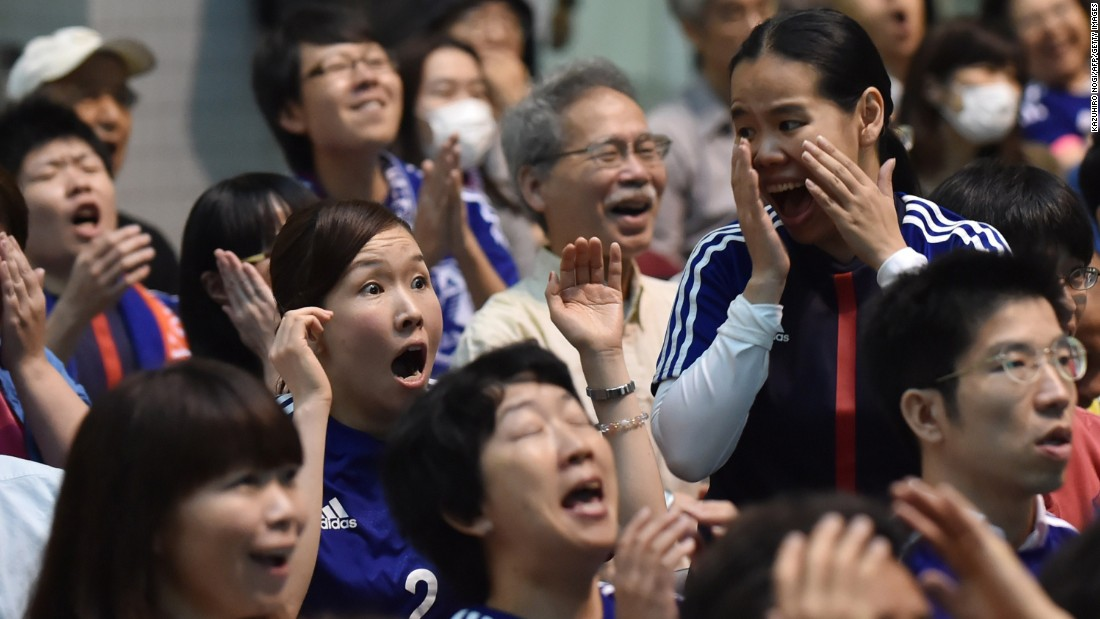 Japanese football fans react to a U.S. goal at a public screening of the game in Tokyo.