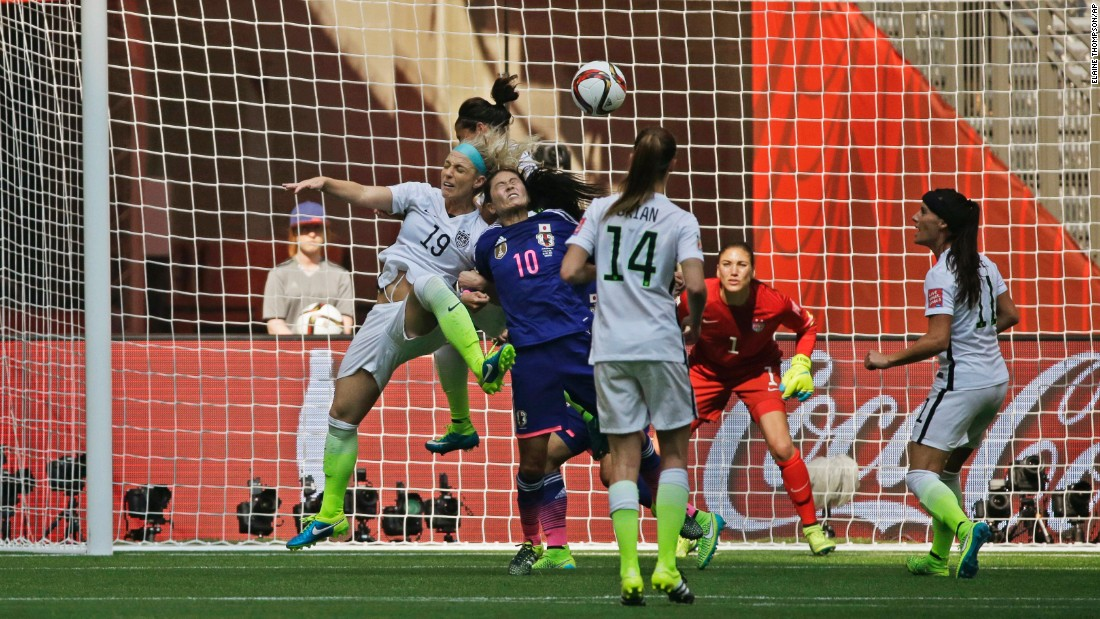 U.S. goalkeeper Hope Solo watches as American Julie Johnston and Homare Sawa of Japan battle for a header during the second half.