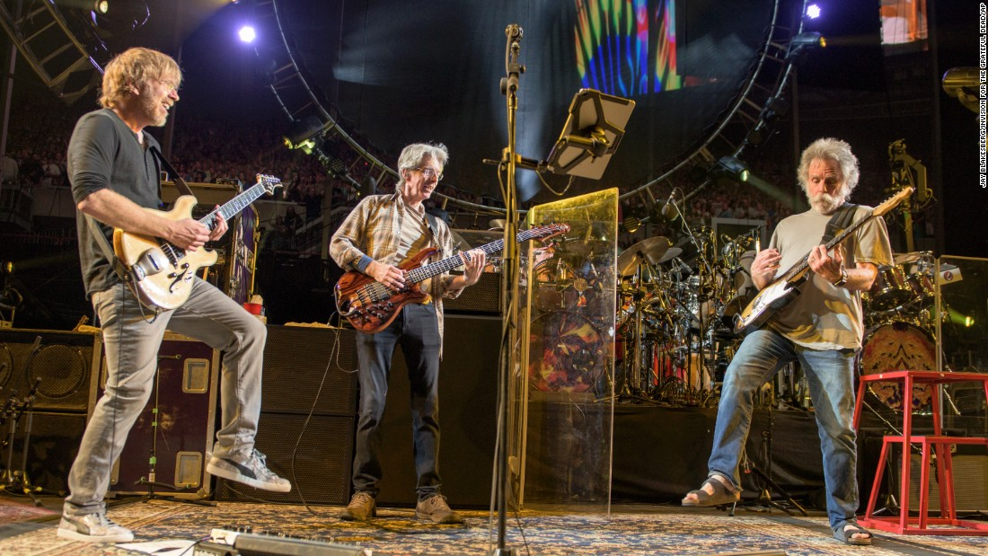"Phish guitarist Trey Anastasio, left, plays with Lesh and Weir at the ""Fare Thee Well"" show in Chicago on Saturday, July 4."