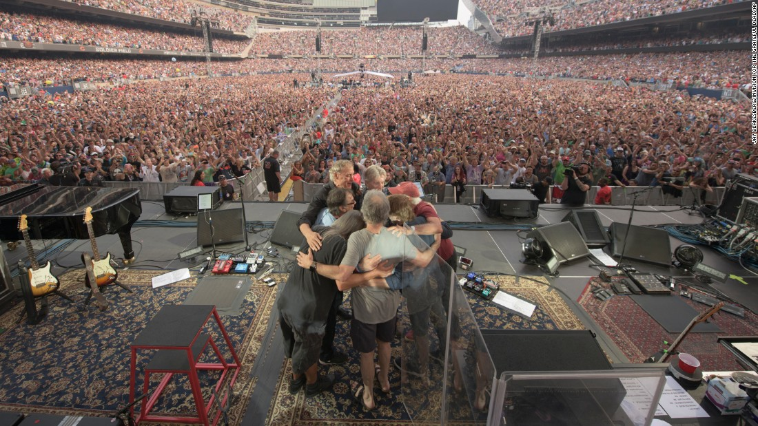 Members and guests of the Grateful Dead embrace during the band's final show on Sunday, July 5, in Chicago.