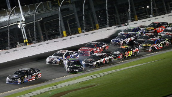 Dale Earnhardt Jr. in the No. 88 Chevrolet crosses the finish line to win as Denny Hamlin in the No. 11 Toyota, begins to lose control and spins.