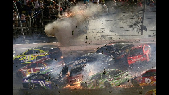 Debris flies off Dillon's car as he hits the fencing.