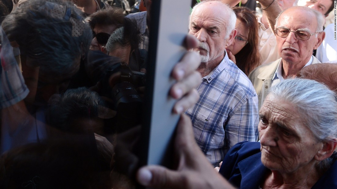Pensioners queue outside a national Bank branch in Athens on Tuesday, July 1, as banks only opened for the retired to allow them to cash up to 120 euros.