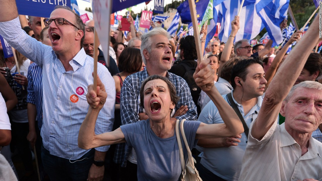 Pro-Europe protesters attend a 'Yes' rally in central Athens. Competing rallies occurred in central Athens late Friday evening as Greek Prime Minister Alexis Tsipras urged thousands of supporters to vote 'No' in the Sunday referendum so as to 'live with dignity in Europe.'