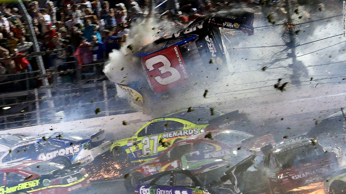 Austin Dillon's car crashes into a fence Sunday, July 5, during a last-lap crash at the NASCAR Sprint Cup race in Daytona Beach, Florida. Dillon walked away from the crash, but several fans were injured.