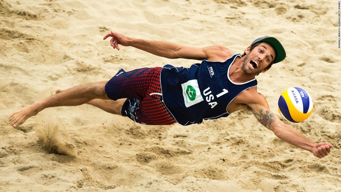 Nicholas Lucena dives for a ball Thursday, July 2, while playing against a team from Qatar in the Beach Volleyball World Championships. The tournament took place in the Netherlands.