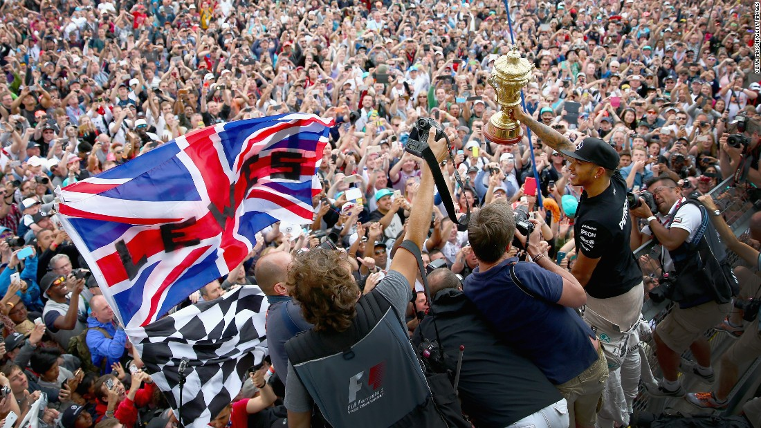 There's no doubt Hamilton has mass appeal. The 30-year-old Briton celebrates victory at the 2015 British Grand Prix with a sea of fans.
