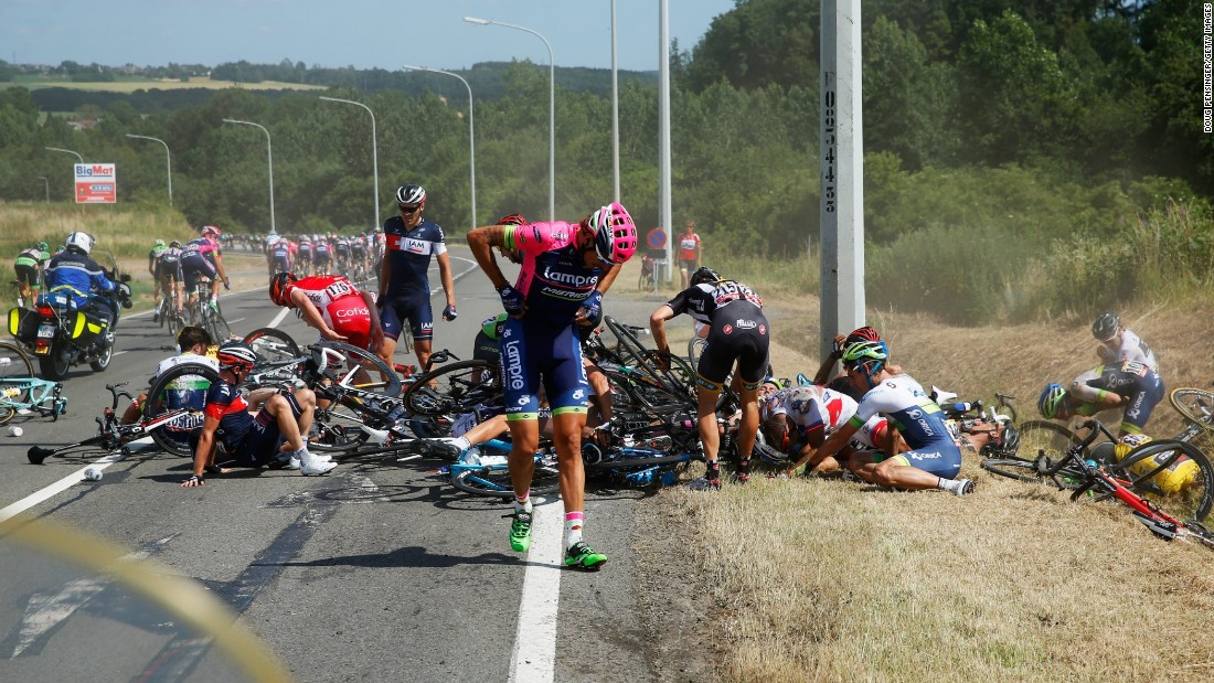 Filippo Pozzato of Italy and Lampre-Merida adjusts his clothing following a horrific high speed crash on the second stage.<br />
