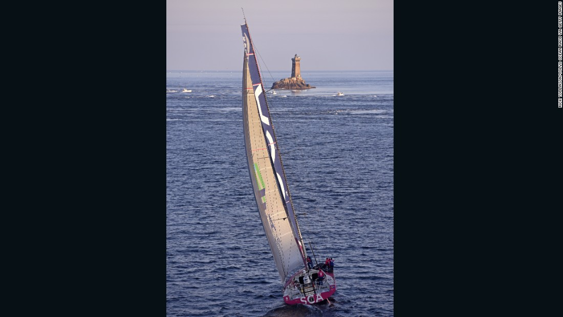 On a sparkling afternoon of sailing, the SCA boat navigates waters by an offshore lighthouse. Each crew in the race sailed an identically-designed boat.