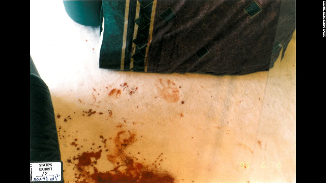 "An evidence photo shows 5-year-old Damon's bloody handprint. He had been stabbed multiple times in the back. <br /><br />During the initial questioning, when she'd regained consciousness after surgery in the hospital for her injuries, Routier told police she woke up to a man standing over her and there was a physical struggle. Later, when she was brought into the police department for questioning, she said she awoke to Damon, dripping with blood, calling out, ""Mommy! Mommy!"""