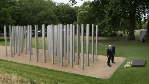LONDON, ENGLAND - JULY 07: London Mayor Boris Johnson (L) British Prime Minister David Cameron place wreathes at the July 7 memorial in Hyde Park on July 7, 2015 in London, England. Today is the tenth anniversary of the 7/7 bombings, when four suicide bombers struck transport system in central London on Thursday 7, July 2005, killing 52 people and injuring more than 770 in simultaneous attacks. (Photo by Steve Parsons- WPA Pool/Getty Images)