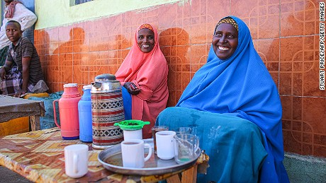 This handout photograph taken and released by the African Union-United Nations Information Support team on February 27, 2012, shows women selling tea in the central Somali town of Buur-Hakba.