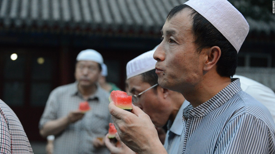 A man enjoys a piece of watermelon on July 6.