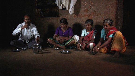 Sakharam Bhagat and his three wives, (from left) Tuki, Sakhri and Bhaagi, eat lunch at their house. Polygamy is illegal and a crime in India, but Bhagat says he had no other option but to marry two more times in order to have more helping hands to get water.
