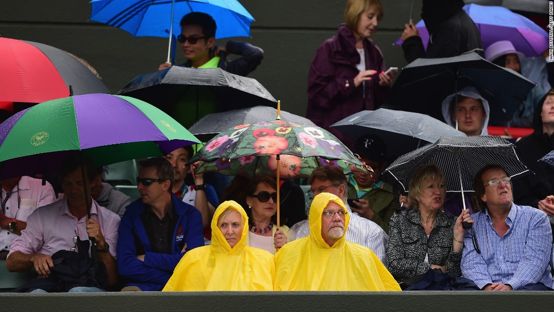 After glorious weather for most of Wimbledon, light rain affected both of the early quarterfinals. The delays were minimal, though, and play was completed well in time.