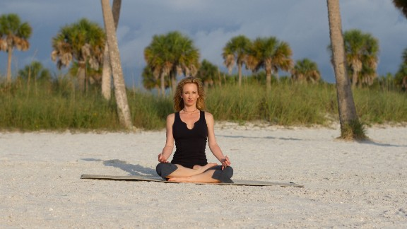 Easy seated pose: Sit cross-legged, facing the ocean. Rest your hands on your legs. Practice yoga's jnana mudra, a symbolic hand gesture of wisdom, by touching your thumb and index finger together. Breathe deeply for five or more breaths, taking in all aspects of your surroundings with your five senses.  Click through the gallery for more yoga poses by the sea: