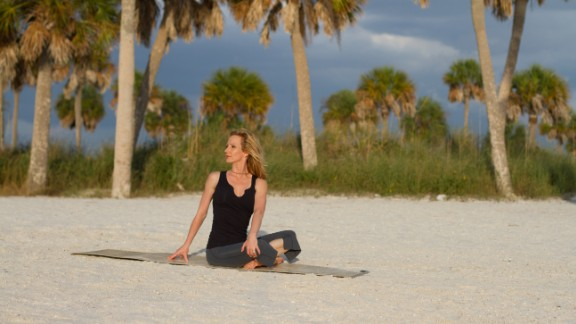 Easy seated twist: From easy seated pose, place your right hand on your left leg. Inhale as you lengthen your spine. Exhale as you rotate from your mid-back to look over your left shoulder and place your left hand down behind you. Take a breath or two. Repeat on the other side.