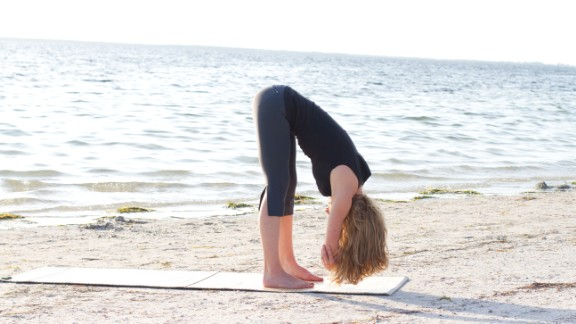 Rag doll: From standing with your feet hip distance, exhale as you bend forward, flexing from your pelvis -- not your low back. Bend your knees as much as needed for comfort. Hold opposite elbows and hang inverted for two or three breaths.