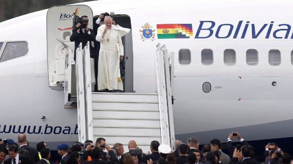 Pope Francis waves goodbye as he prepares to depart Quito, Ecuador, on July 8.