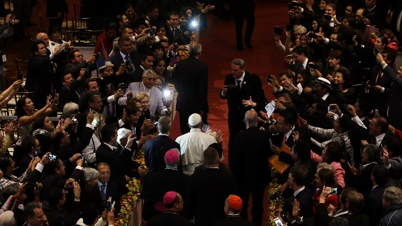 The Pope is cheered upon his arrival at the St. Francis Church in Quito on Tuesday, July 7.