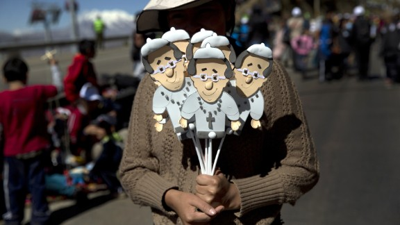 A street vendor sells cutout images of Pope Francis near the airport in El Alto, Bolivia, on Wednesday, July 8. Memorabilia is being sold across South America to commemorate the Pope