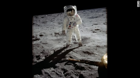 Astronaut Buzz Aldrin walks on the surface of the moon near the leg of the lunar module Eagle during the Apollo 11 mission. Mission commander Neil Armstrong took this photograph with a 70mm lunar surface camera. While astronauts Armstrong and Aldrin explored the Sea of Tranquility region of the moon, astronaut Michael Collins remained with the comma