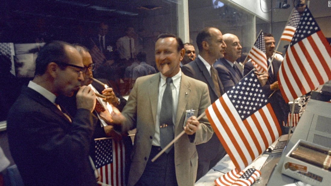 Back on Earth, NASA officials celebrate the successful conclusion of Apollo 11's eight-day mission.