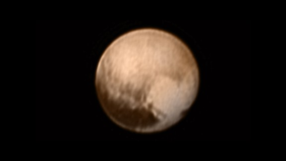 Do you see a heart on Pluto? This image was taken on July 7 by New Horizons when it was about 5 million miles from the planet. Look to the lower right, and you'll see a large bright area -- about 1,200 miles across -- that resembles a heart.