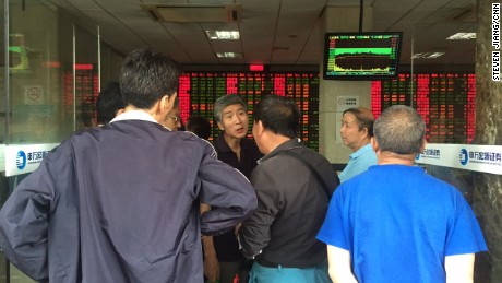 Postmortem: Elderly investors trade opinions on the stock markets at a brokerage house in downtown Shanghai after another major sell-off on Wednesday.