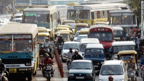 Cars, motorcycles, and buses form a massive traffic jam in a street in central New Delhi. Jams like these are daily occurrence, and can block emergency services access to accident sites.